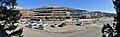 Oasen shopping mall (kjøpesenter, bydelssenter) in Folke Bernadottes vei, Fyllingsdalen, Bergen, Norway. Bergen Taxi, Skyss bus station, main entrance, etc. Distorted panorma 2018-03-17.jpg