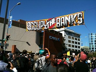 2011 Oakland general strike - A banner hung in downtown Oakland during a bank march