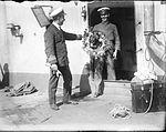 Officers with a wreath on HMAS Australia.jpg