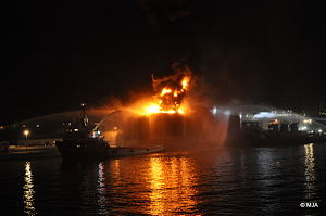 North Mole, Gibraltar Harbour - Oil Sullage Tank continues burning through the night