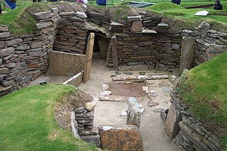 32nd century BC - Excavated dwellings at Skara Brae, Europe's most complete Neolithic village.