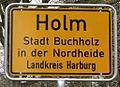 Ortseingangsschild Holm DSC03422a.jpg