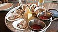 Oysters with mignonette sauce and cocktail sauce.jpg