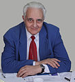 Paul Schwartz at his Jewish community office, Bucharest, Romania.jpg