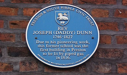 Plaque in Fox Street commemorating the work of Reverend Joseph Dunn in bringing gas lighting to the town Plaque in Preston Lancashire commemorating Rev Joseph (Daddy) Dunn and first gas-lit building.jpg