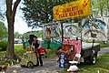 Playing the street organ at start of show - Alberti Flea Circus & Strolling Street Organ, MerleFest 2013.jpg