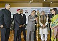 Pranab Mukherjee lighting the lamp to inaugurate the Northern India Chief Ministers' Conclave, in New Delhi. The Chief Minister of Chhattisgarh, Dr. Raman Singh, the Chief Minister of Himachal Pradesh.jpg
