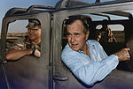 President Bush rides in a HUMVEE with General H. Norman Schwarzkopf during his visit with troops in Saudi Arabia on... - NARA - 186424.jpg