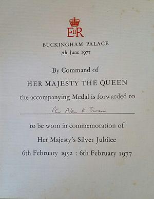 Queen Elizabeth II Silver Jubilee Medal - Queens Silver Jubilee Medal Certificate, as Awarded to PC. Alan E Swain.