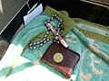 Quran beads and pen at anti-coup sit-in outside Rabaa al-Adawiya mosque Cairo 11-July-2013.jpg