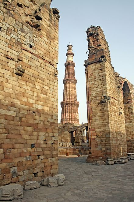 Qutub Minar is the world's tallest brick minaret, commenced by Qutb-ud-din Aybak of the Slave dynasty; 1st dynasty of the Delhi Sultanate. Qutb minar ruins.jpg