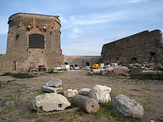 Red Basilica - South rotunda and a surviving section of the south wall of the temenos. Holes for the beams of the stoa roof can still be seen in the temenos wall.