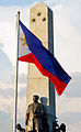 Rizal Monument and Flag in golden afternoon light.jpg