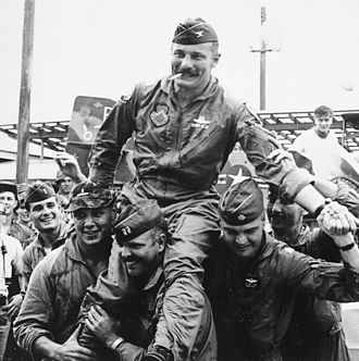 "Robin Olds - ""Wolfpack"" aviators of the 8th Tactical Fighter Wing carry their commanding officer, Colonel Robin Olds, following his return from his last combat mission over North Vietnam, on 23  September 1967."