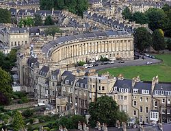 Royal Crescent, seen                   from a hot air balloon. There is a contrast between                   the architectural style of the public front and the                   private rear of this crescent.