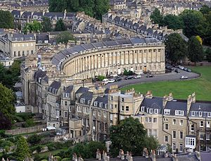 Royal Crescent - Royal Crescent from a hot air balloon, contrasting its uniform public front façade against its more architecturally varied private rear.