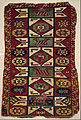 Rug with Star Motifs and Animals - Google Art Project.jpg