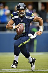 884396ad Russell Wilson wearing the current Seahawks home uniform.