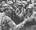 SAF adviser briefing Montagnard strike force before moving out against nearby Viet Cong guerrillas.png