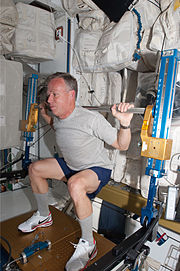 STS-133 Steve Lindsey exercises using the aRED