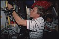 STS095-324-011 - STS-095 - Parazynski in the Spacehab module - DPLA - 66a63116f6db71116a60ae893c494e10.jpg