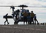 Sailor remove chocks and chains from an MH-60S Sea Hawk aboard USS Makin Island. (29566783512).jpg
