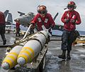 Sailors transport ordnance on the flight deck of USS Carl Vinson. (32384508620).jpg