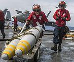 Sailors transport ordnance on the flight deck of USS Carl Vinson. (32384508620).jpg