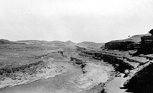 Downcutting - Several stages of downcutting by the San Juan River in Utah can be identified in this 1927 photo.  Remnants of former floodplains stand as terraces above the river's modern level.