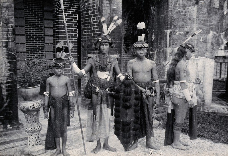 Sea Dayaks with weapons and head-dresses