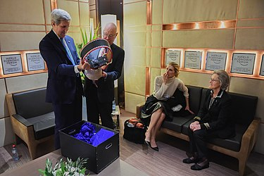 Secretary Kerry Admires Engraved Cowbell Given to Him by World Economic Forum Founder Schwab Before Delivering Keynote Address at Annual Meeting in Switzerland (24510898346).jpg