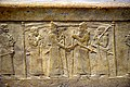 Shalmaneser III greets Marduk-zakir-shumi, detail, front panel, Throne Dais of Shalmaneser III at the Iraq Museum.jpg