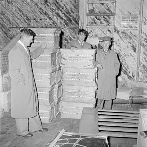 Sir Edmund Hillary, J.H. Miller and R. Cawdrey with a shipment of eggs for the HMNZS Endeavour, 1956.jpg
