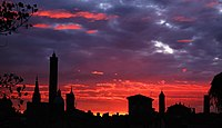 Skyline of Bologna against the sunset.jpg