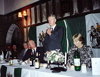 Conservative Monday Club - Ian Smith makes a point at a dinner organised in his honour by The Hon. Denis Walker (far left) at Lympne Castle, Kent, 23 July 1990. Smith is flanked by Nicholas and Ann Winterton, both MPs, and Rhodesian flags.