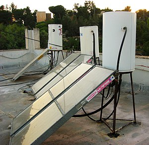 English: Solar boiler on a rooftop in Israel.