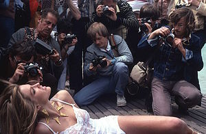 Media ethics - Photographers crowd around a starlet at the Cannes Film Festival.