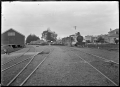 Steam locomotive Class Ua number 177 hauling empty logging wagons past Winton railway station, Southland. ATLIB 292881.png
