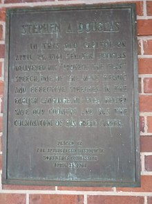 "brown plaque on red brick wall reading ""In this old capitol on April 25, 1861, Senator Douglas delivered his 'Protect the Flag' speech, one of the most heroic and effective speeches in the English language. His plea helped save our country and was the culmination of his great career."""