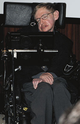 Hawking sitting in his wheelchair inside