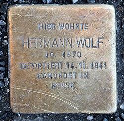 Photo of Hermann Wolf brass plaque