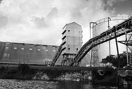 A sugar cane processing plant, Orange Walk Town, Belize. Sugar is one of Belize's top exports. Sugar Cane Processing Plant 2.jpg