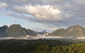 Sunny mist in the mountains at golden hour, South-West view from Mount Nam Xay, Vang Vieng, Laos.jpg