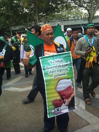 Malaysian general election, 2013 - A PAS supporter at a rally calling for the removal of unfair government policies at the ''Himpunan Kebangkitan Rakyat'', January 2013.