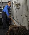 Sweeping water out of the hangar bay 130118-N-PW661-002.jpg