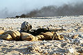 Syrian soldier with a machine gun.JPEG