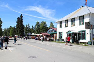 Talkeetna, Alaska - Tourists on Main street in Talkeetna, Alaska in June 2015