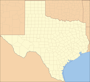 A map of the state of Texas with a red dot on the northeast corner