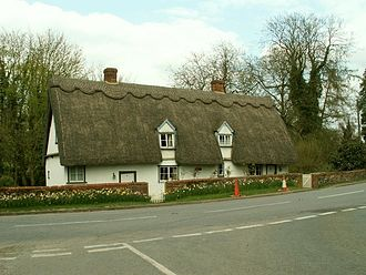 Chartered Surveyor - A thatched cottage