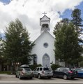 "The ""old"" St. Mary's Catholic Church in Breckenridge, Colorado, built in 1881 and moved to its present location in 1890 (with a belfry added in 1899). The building sits near a ""near"" St. Mary's LCCN2015633635.tif"